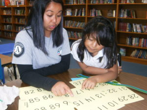 JV Ivy Buena teaching first grader to recognize numbers