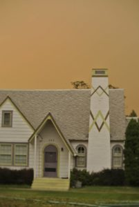 Foreboding skies linger behind a house in Omak, WA