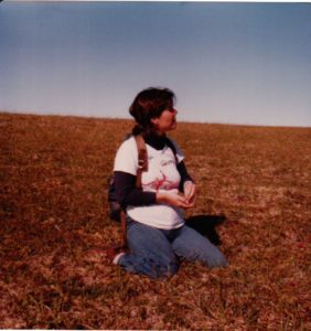 Jane picking blueberries on the tundra circa 1978