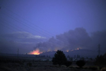 Fires burn at dusk near Omak