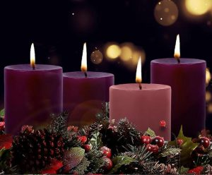 4 wide light candles, 3 maroon, one pink, with holy garnish