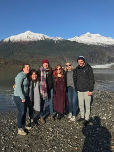 Six people in from of the Mendenhall Glacier