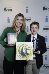 mother and son with awards